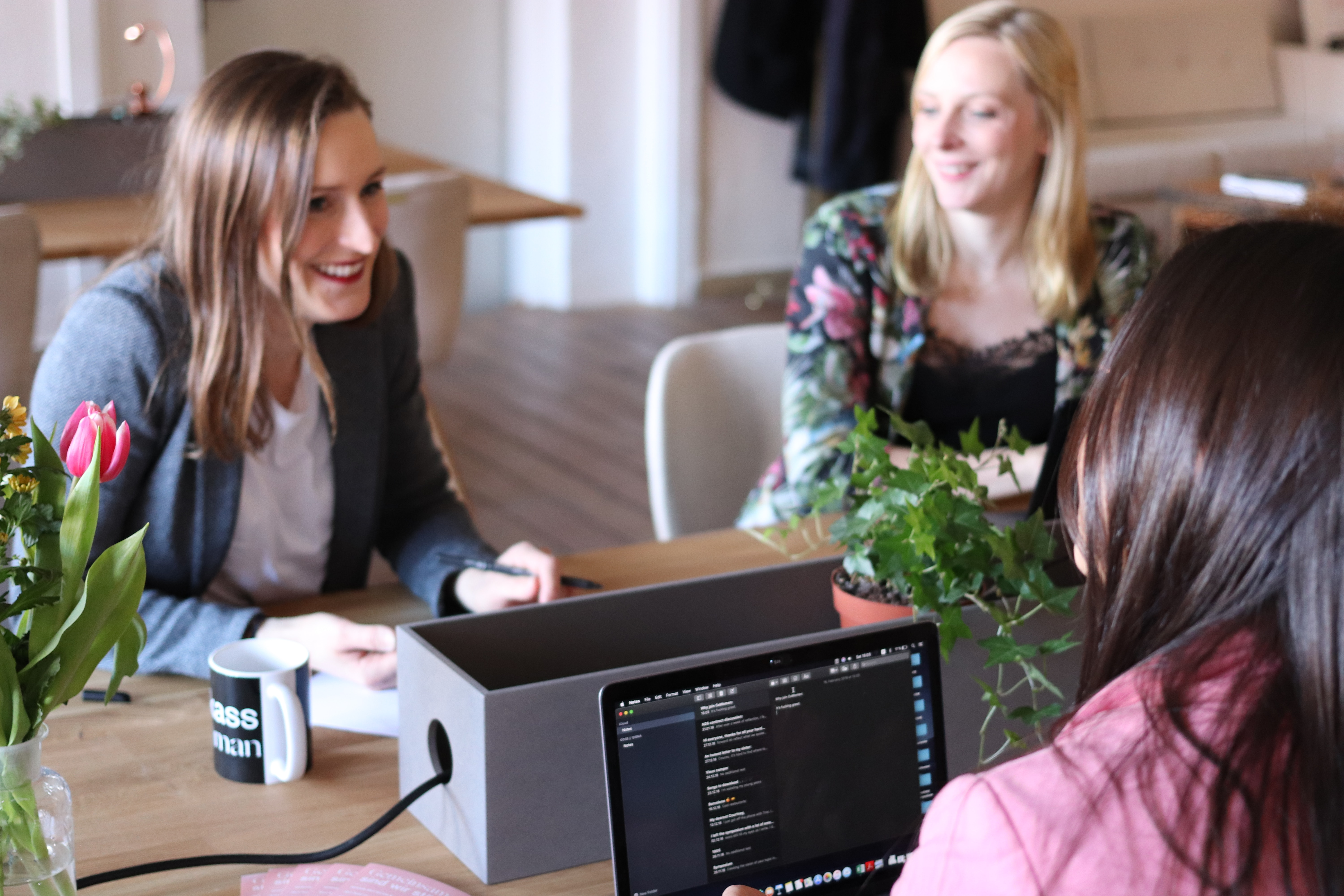 Women coding software in a coworking space