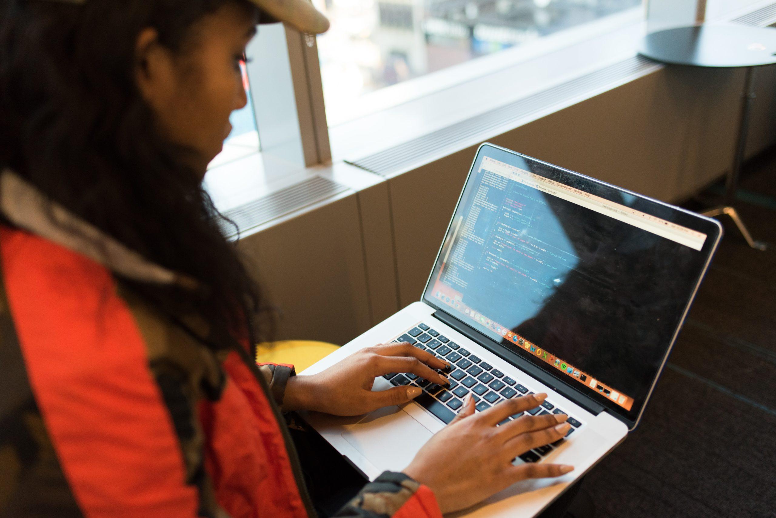 Girl learning online programming